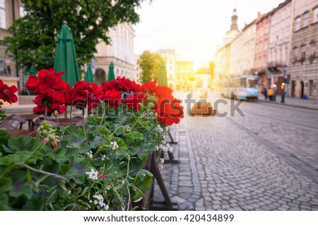 Street of old European city at early morning - stock photo