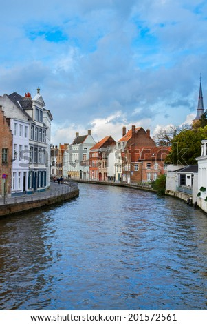 street of old town of Bruges with canal, Belgium
