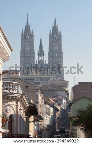 Street of QuIto early in the morning with the Basilica del Voto Nacional in the background. A Roman Catholic Church in Quito, Ecuador. This is the largest Neo-Gothic basilica in the Americas.  - stock photo