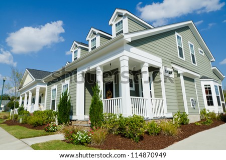 Street of residential cottage style homes - stock photo