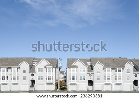 Street of residential development of modern attached townhouses. - stock photo