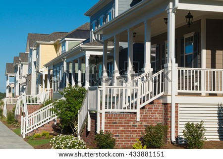 Street of residential houses with porches - stock photo