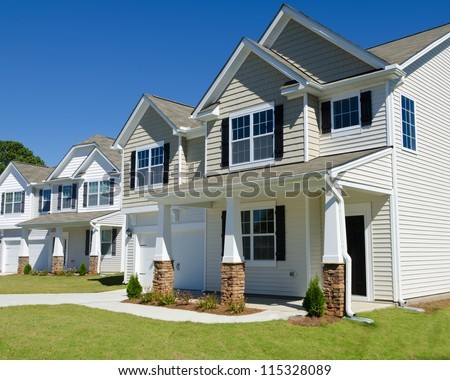 Street of residential houses with vinyl siding - stock photo