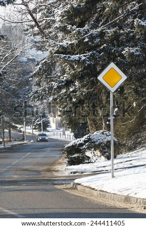 Street of the city in winter. Traffic sign the main road - stock photo