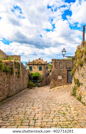 Street of the medieval village Volterra, province of Pisa, Tuscany, Italy - stock photo