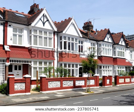Street of typical west London small Edwardian terraced houses built in 1913, without parked cars - stock photo