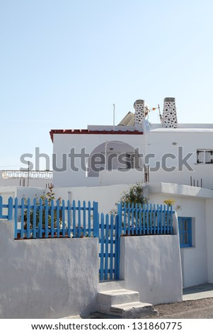 Street on Santorini island in the Cylcades and cats (Greece) - stock photo