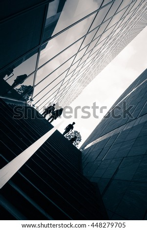 Street photography in Tokyo, detail of the architecture and silhouettes figure in the Ginza business district. - stock photo