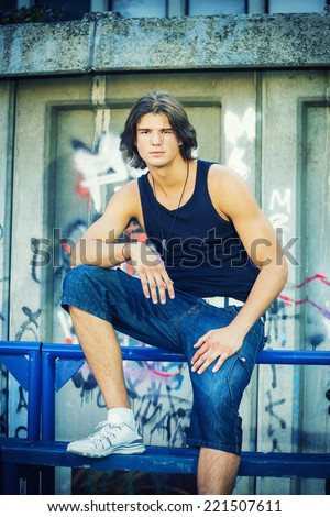 Street portrait of a handsome young man - stock photo