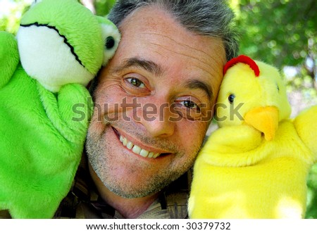Street puppet theatre. Actor with dolls - stock photo