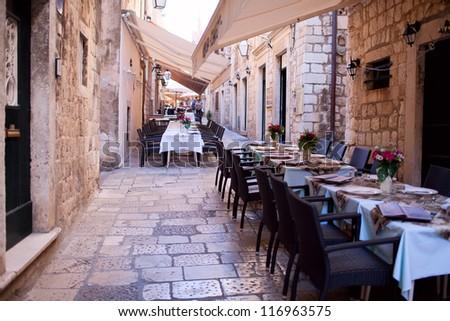 Street restaurant in heart of Dubrovnik old town, Europe - stock photo