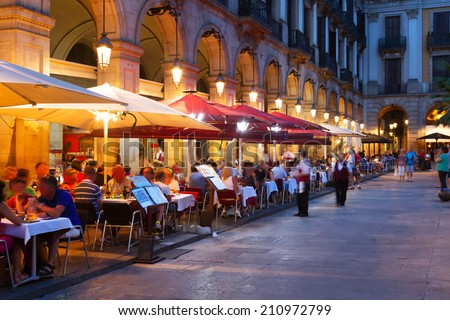 Street restaurants at Placa Reial in summer night. Barcelona, Spain - stock photo