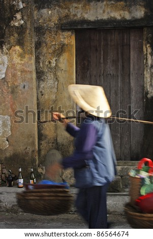 Street scene in Hoi An in Vietnam South East Asia - stock photo