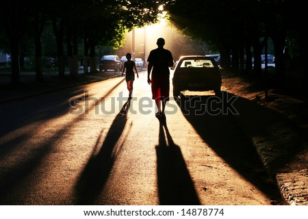 Street scene on sunset - stock photo