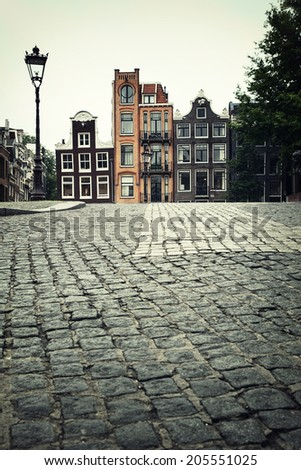 Street scene showing traditional architecture, Amsterdam. Filtered to look like an aged instant photo. - stock photo