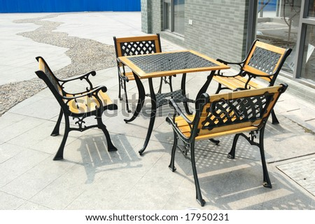 Street scene with big windows and chair and table - stock photo