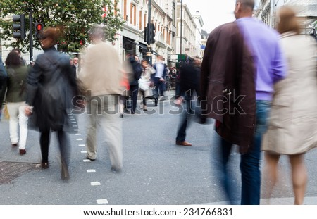 street scene with blurred people in the city of London, UK - stock photo