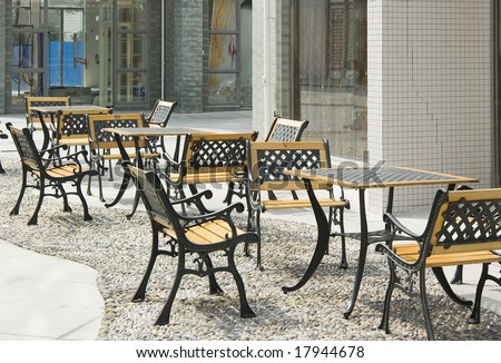 Street scene with chairs and tables in a Chinese city - stock photo