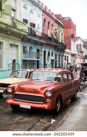 Street scene with old car on rainy day in Havana,Cuba - stock photo