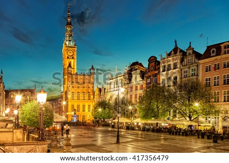 Street scene with renaissance building of the former Town Hall in Gdansk, Poland. - stock photo