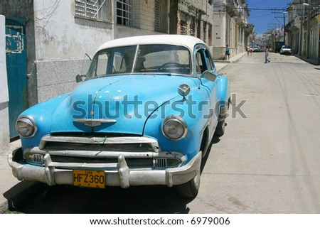 Street scene with vintage Chevy in central Havana