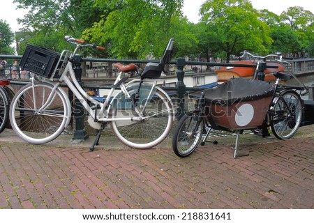 street scenery with bicycles seen in Amsterdm (Netherlands) - stock photo