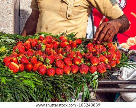 Street selling strawberries in Rishikesh, India.