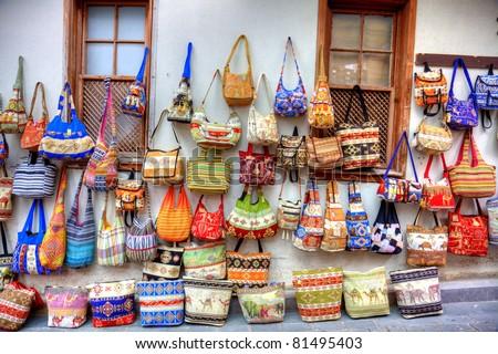 Street shopping handbags display - stock photo