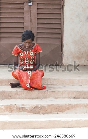 Street Shot: African College Woman Studying With her Tablet Computer - stock photo