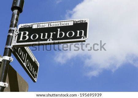 Street sign for the world famous Bourbon Street in the French Quarter in New Orleans famous for its party atmosphere - stock photo