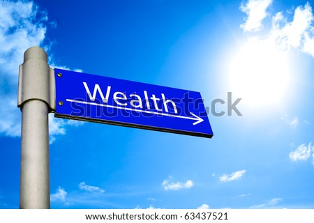 Street sign in front of blue sky showing the way to wealth