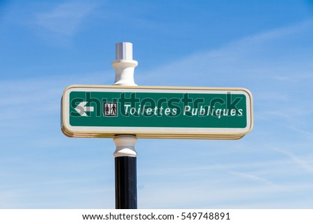 Street sign indicating a public toilette in France