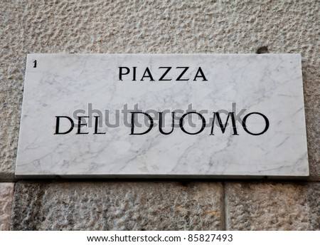 Street sign of famous interesting point in Milan center - Italy - stock photo