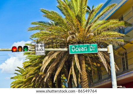 street sign of famous street Ocean Drice in Miami South with traffic light - stock photo