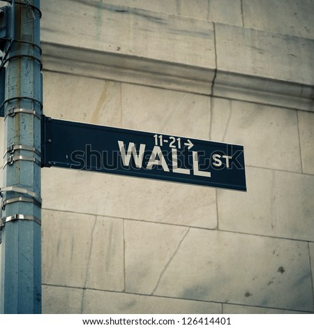 Street sign of New York Wall street - stock photo