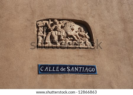 Street sign on adobe wall in the Plaza area of Mesilla, New Mexico, USA.  Mesilla is a famous and historic town in southern New Mexico next to Las Cruces. - stock photo