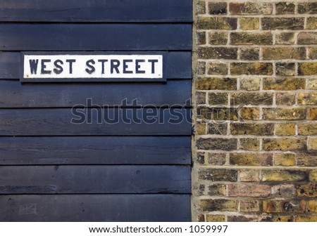 Street sign on wall - stock photo