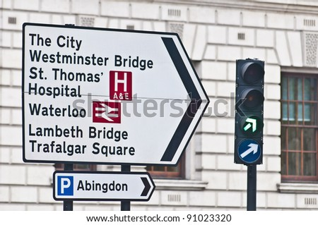 Street sign pointing to different landmarks at London, England - stock photo
