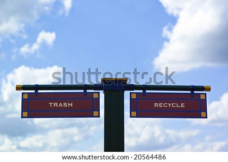 Street sign showing the words trash and recycle