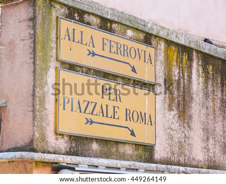 Street sign to Railway station and Piazzale Roma - VENICE, ITALY - JUNE 30, 2016