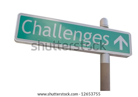 "Street sign with an arrow and the word ""challenges"" - stock photo"