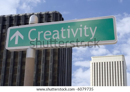 "Street sign with an arrow and the words ""creativity"" located in a business district - stock photo"