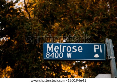 Street sign with the name Melrose place - stock photo