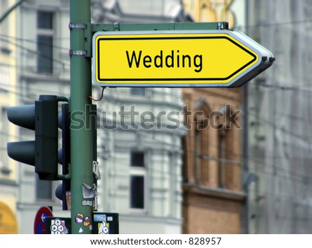 street sign with the word wedding