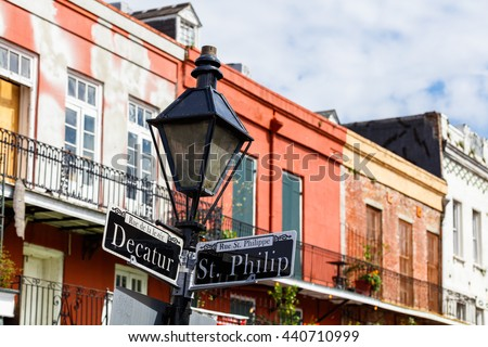 Street signs and architecture of the French Quarter in New Orleans, Louisiana.