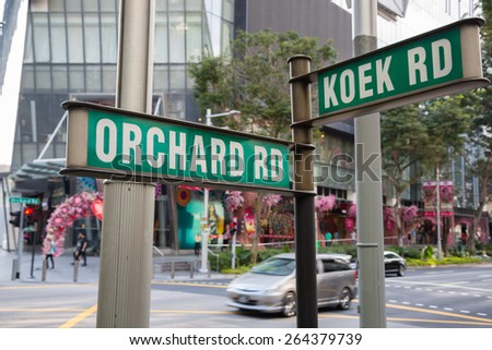 Street signs that says Orchard Road and Koek Road, Singapore.