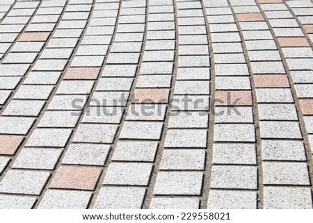 Street stone block pavement texture and background - stock photo