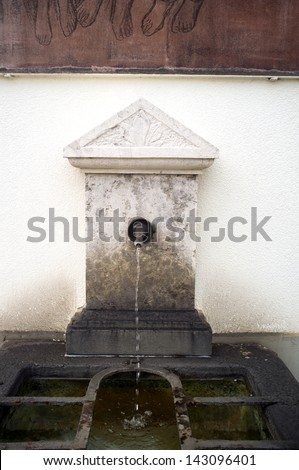 Street tap with running water - stock photo
