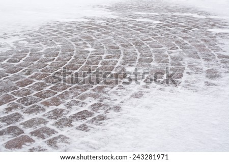 Street tiles with snow  in a blizzard in V�¤llingby, Stockholm, Sweden in January. - stock photo