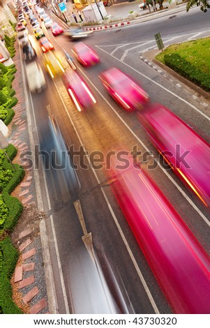Street traffic, cars with motion blur - stock photo